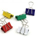 Binder clips to keep packages in place