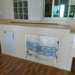 Kitchen storage using brick, cement and tiles