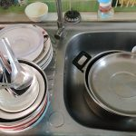 Systematically wash dishes, pots and pans