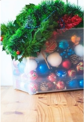 storing christmas decorations in clear storage container